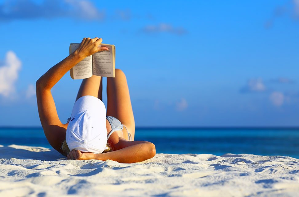 girl-reading-on-beach